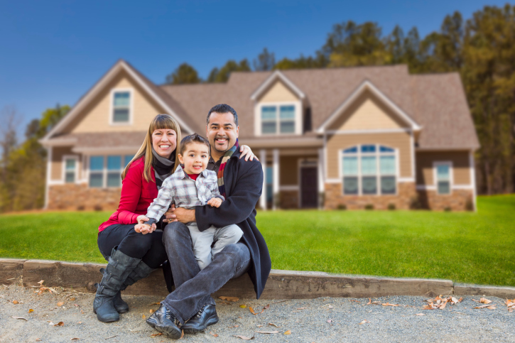 Family With Kids in Front Of New house small down payment