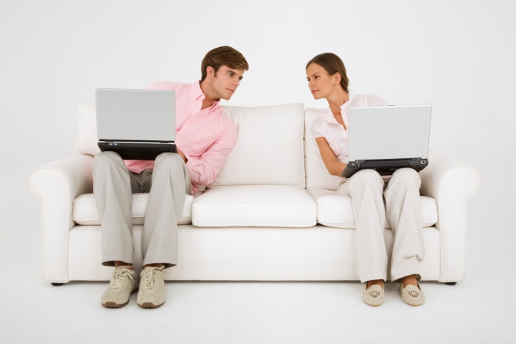 Couple comparing computer screens