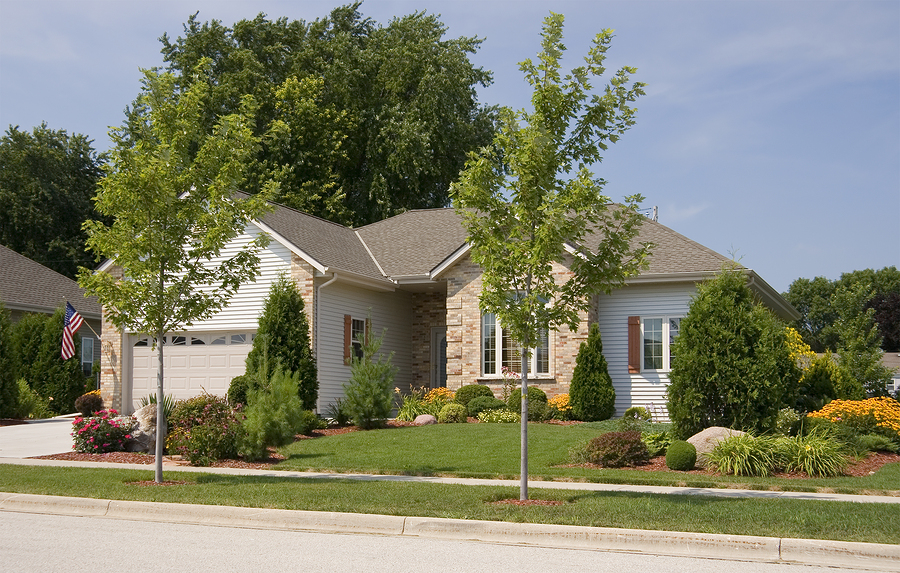 A Small But Nicely Landscaped Home In The Suburbs With Garage