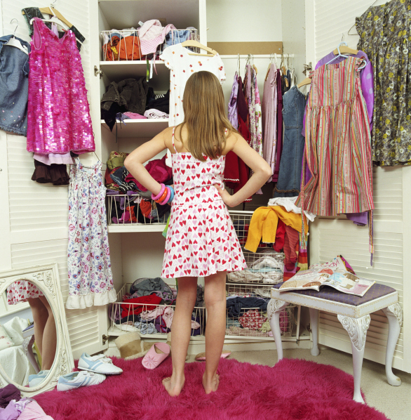 Image of girl looking into messy closet