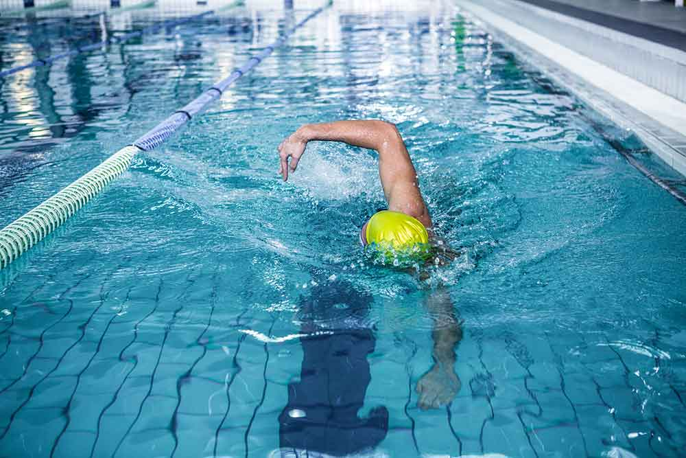 bigstock-Fit-man-swimming-with-swimming-115035323