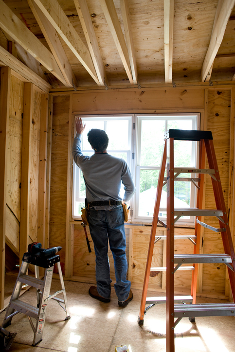 Image of Contractor working on window in new home