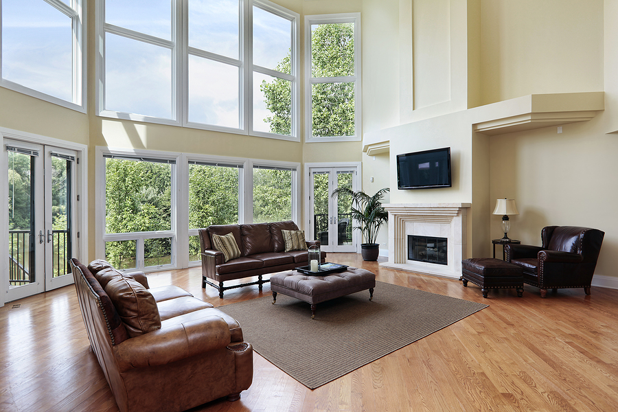 Living room in luxury home witih two story windows
