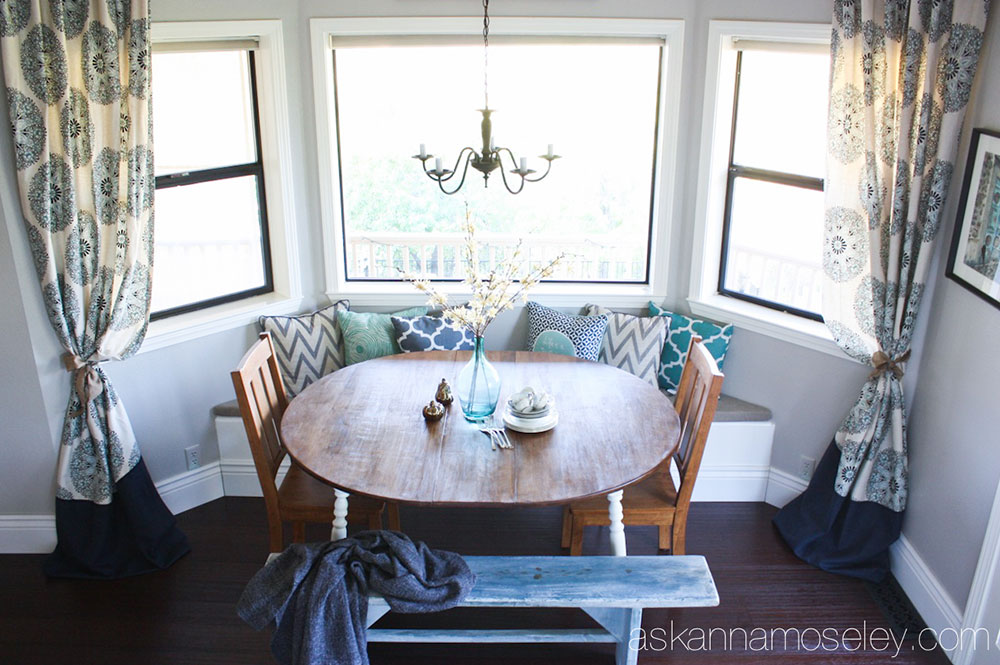 A breakfast nook with pillows and blankets