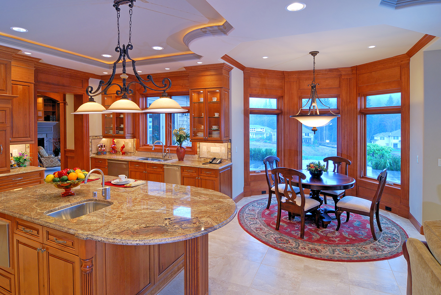 Image of open Kitchen with bay window nook and granite counter top