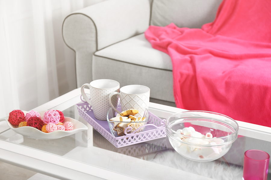 Low table with sweets and two cups in living room