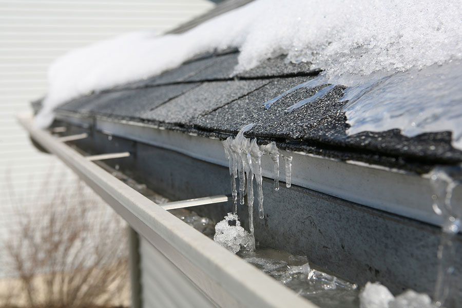 bigstock-Ice-on-roof-and-gutters-54096533