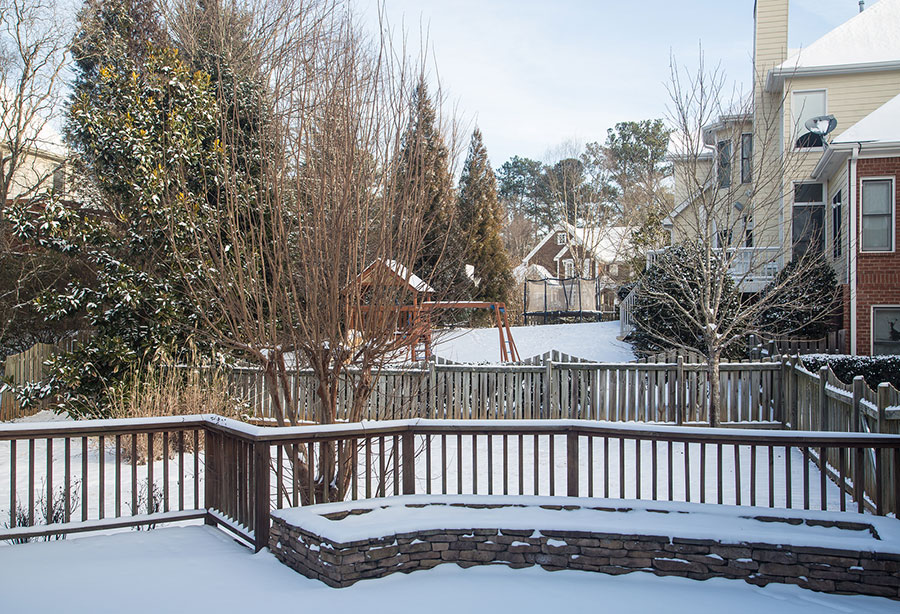 bigstock-Snow-In-Back-Yards-Of-Homes-58600181