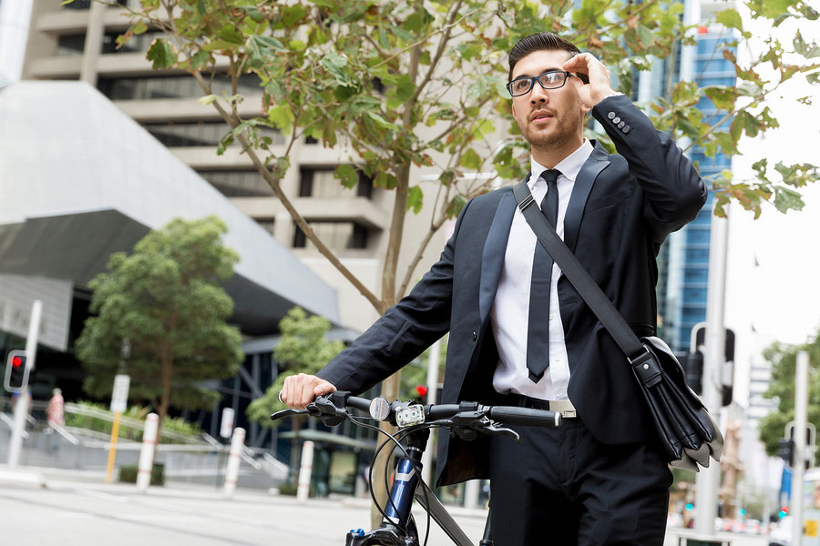 bigstock-Young-businessmen-with-a-bike-151575773
