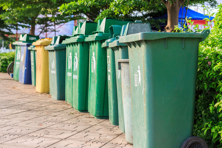 bigstock-Trash-Cans-In-A-Row-89192576