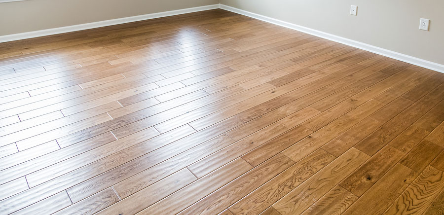 bigstock-Shiny-New-Hardwood-Floor-94137134