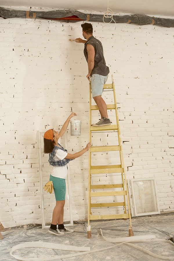 bigstock-Young-couple-renovating-home-145801424