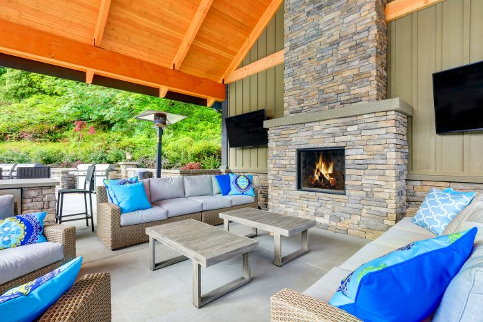 A nice sized outdoor fire place.