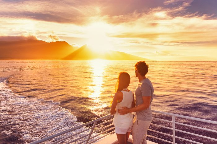 Couple on cruise ship at sunset in Hawaii.