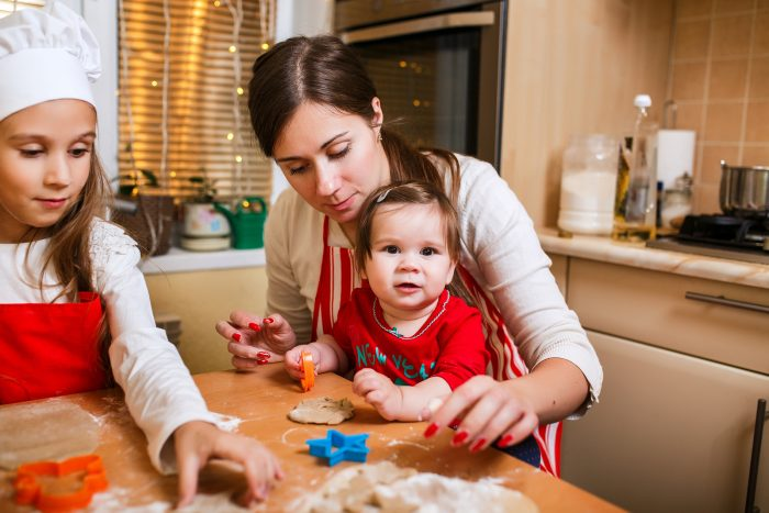 Mother and daughters cooking Christmas cookies.